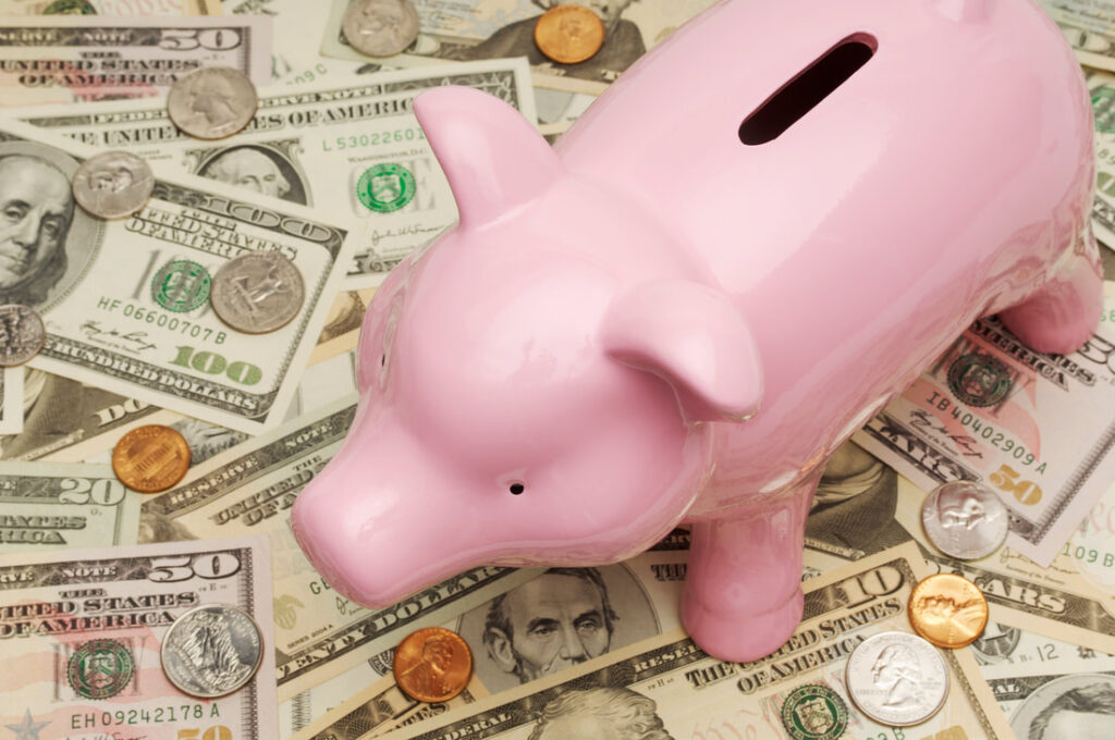 Saving money in piggy bank | FILE YOUR TAXES IN ITALY IN 2020