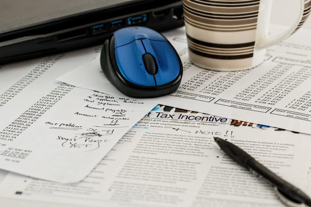 730 Tax form in Italy   Tax papers with mouse and coffee mug