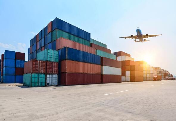 How to export to Italy | Cargo harbour with plane flying over