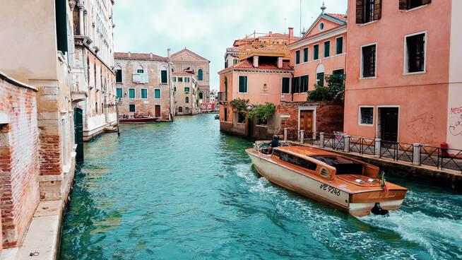 Italy's Golden visa program | Elegant boat running through Venice's channels