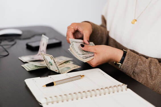Italian Payroll deduction   Employer counting money with papernotePicture