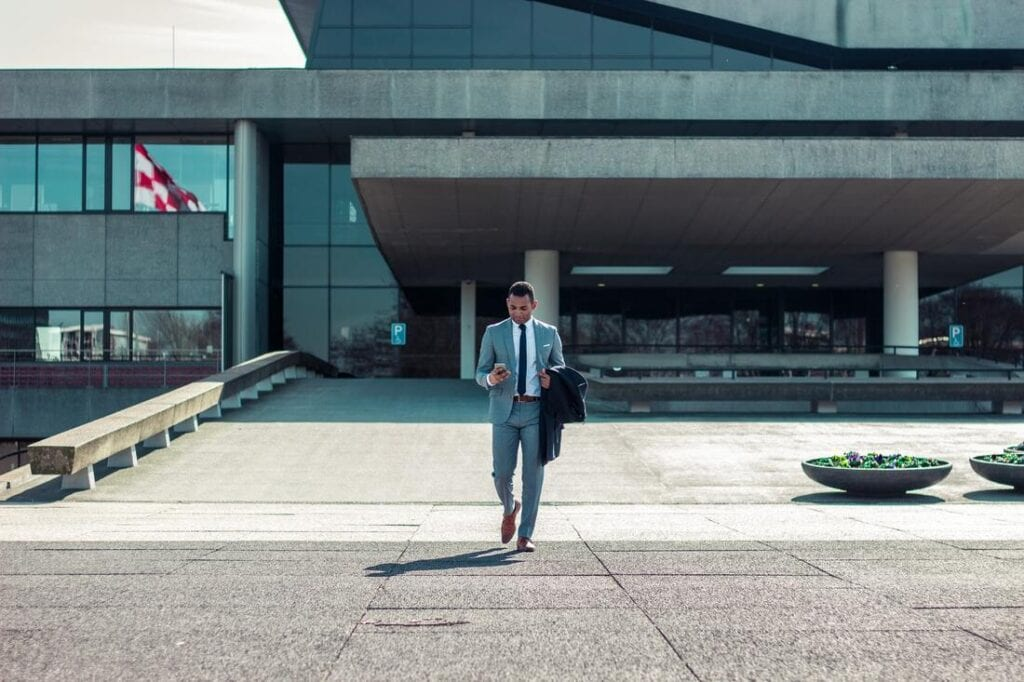 Business man walking alone outside office | Business etiquette in Italy