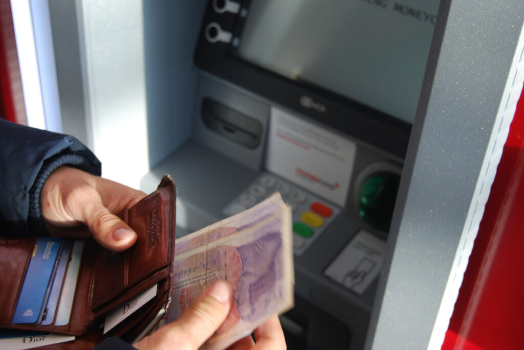 Man withdrawing money from Atm | Cash limit in Italy